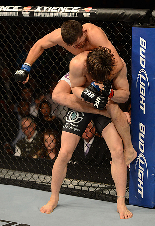 LAS VEGAS, NV - FEBRUARY 02:  Demian Maia (top) punches Jon Fitch during their welterweight fight at UFC 156 on February 2, 2013 at the Mandalay Bay Events Center in Las Vegas, Nevada.  (Photo by Donald Miralle/Zuffa LLC/Zuffa LLC via Getty Images) *** Local Caption *** Jon Fitch; Demian Maia