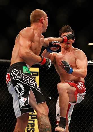LAS VEGAS, NV - MAY 25:   (L-R) Donald Cerrone punches Karl Noons in their lightweight bout during UFC 160 at the MGM Grand Garden Arena on May 25, 2013 in Las Vegas, Nevada.  (Photo by Josh Hedges/Zuffa LLC/Zuffa LLC via Getty Images)  *** Local Caption *** Donald Cerrone; Karl Noons