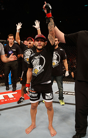 RIO DE JANEIRO, BRAZIL - AUGUST 03:  John Lineker reacts after his knockout victory over Jose Maria in their flyweight bout during UFC 163 at HSBC Arena on August 3, 2013 in Rio de Janeiro, Brazil. (Photo by Josh Hedges/Zuffa LLC/Zuffa LLC via Getty Images)
