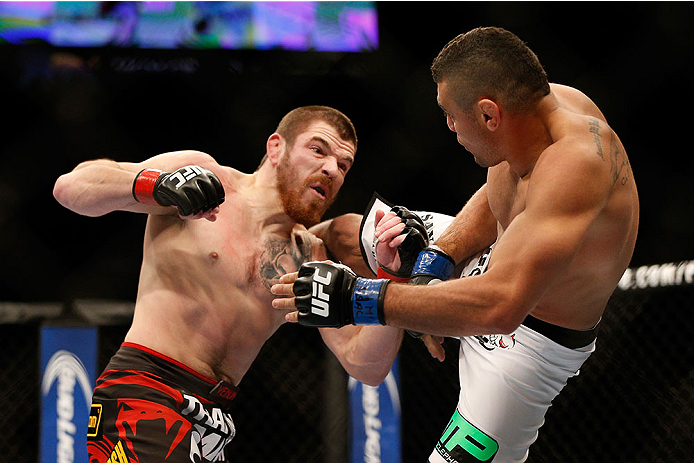 LAS VEGAS, NV - DECEMBER 28:  (L-R) Jim Miller punches Fabricio Camoes in their lightweight bout during the UFC 168 event at the MGM Grand Garden Arena on December 28, 2013 in Las Vegas, Nevada. (Photo by Josh Hedges/Zuffa LLC/Zuffa LLC via Getty Images) *** Local Caption *** Jim Miller; Fabricio Camoes