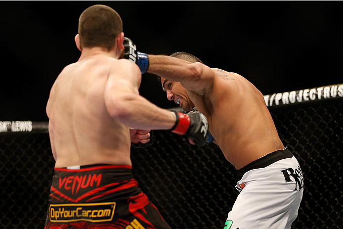 LAS VEGAS, NV - DECEMBER 28:  (R-L) Fabricio Camoes punches Jim Miller in their lightweight bout during the UFC 168 event at the MGM Grand Garden Arena on December 28, 2013 in Las Vegas, Nevada. (Photo by Josh Hedges/Zuffa LLC/Zuffa LLC via Getty Images) *** Local Caption *** Jim Miller; Fabricio Camoes