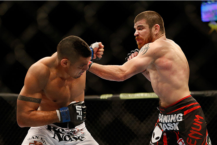 LAS VEGAS, NV - DECEMBER 28:  (R-L) Jim Miller punches Fabricio Camoes in their lightweight bout during the UFC 168 event at the MGM Grand Garden Arena on December 28, 2013 in Las Vegas, Nevada. (Photo by Josh Hedges/Zuffa LLC/Zuffa LLC via Getty Images) *** Local Caption *** Jim Miller; Fabricio Camoes