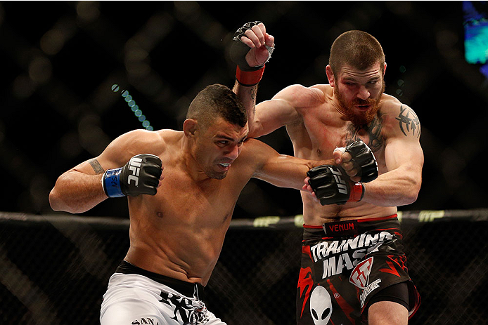 LAS VEGAS, NV - DECEMBER 28:  (L-R) Fabricio Camoes punches Jim Miller in their lightweight bout during the UFC 168 event at the MGM Grand Garden Arena on December 28, 2013 in Las Vegas, Nevada. (Photo by Josh Hedges/Zuffa LLC/Zuffa LLC via Getty Images) *** Local Caption *** Jim Miller; Fabricio Camoes
