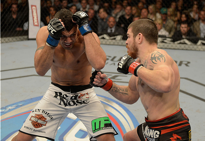 LAS VEGAS, NV - DECEMBER 28:  (R-L) Fabricio Camoes punches Jim Miller in their lightweight bout during the UFC 168 event at the MGM Grand Garden Arena on December 28, 2013 in Las Vegas, Nevada. (Photo by Donald Miralle/Zuffa LLC/Zuffa LLC via Getty Images) *** Local Caption *** Jim Miller; Fabricio Camoes