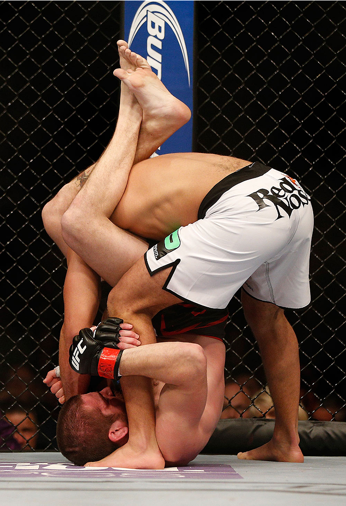 LAS VEGAS, NV - DECEMBER 28:  Jim Miller (bottom) attempts to submit Fabricio Camoes in their lightweight bout during the UFC 168 event at the MGM Grand Garden Arena on December 28, 2013 in Las Vegas, Nevada. (Photo by Josh Hedges/Zuffa LLC/Zuffa LLC via Getty Images) *** Local Caption *** Jim Miller; Fabricio Camoes