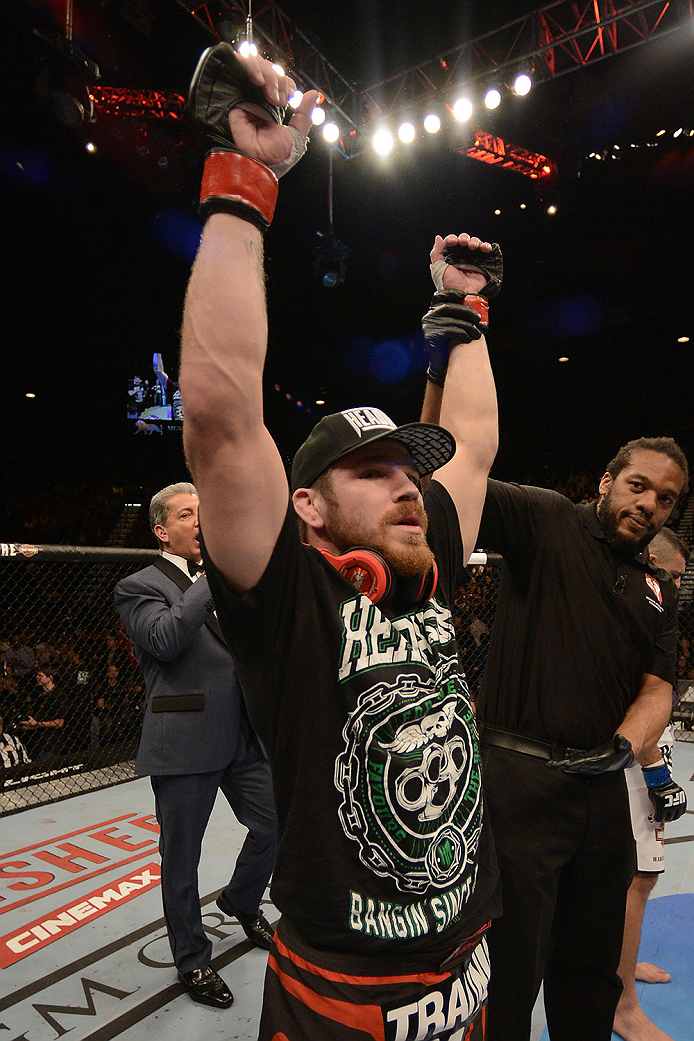 LAS VEGAS, NV - DECEMBER 28:  Jim Miller reacts to his victory over Fabricio Camoes in their lightweight bout during the UFC 168 event at the MGM Grand Garden Arena on December 28, 2013 in Las Vegas, Nevada. (Photo by Donald Miralle/Zuffa LLC/Zuffa LLC via Getty Images) *** Local Caption *** Jim Miller