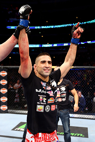 CHICAGO, IL - JANUARY 26:  Ricardo Lamas celebrates after defeating Erik Koch during their Featherweight Bout part of UFC on FOX at United Center on January 26, 2013 in Chicago, Illinois.  (Photo by Al Bello/Zuffa LLC/Zuffa LLC Via Getty Images)