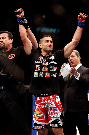 CHICAGO, IL - JANUARY 26:  Ricardo Lamas celebrates after defeating Erik Koch during their Featherweight Bout part of UFC on FOX at United Center on January 26, 2013 in Chicago, Illinois.  (Photo by Josh Hedges/Zuffa LLC/Zuffa LLC Via Getty Images)