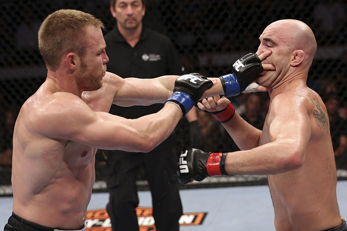 CALGARY, CANADA - JULY 21: (L-R) James Head puts his hands to the face of Brian Ebersole during their welterweight bout at UFC 149 inside the Scotiabank Saddledome on July 21, 2012 in Calgary, Alberta, Canada.  (Photo by Nick Laham/Zuffa LLC/Zuffa LLC via Getty Images)