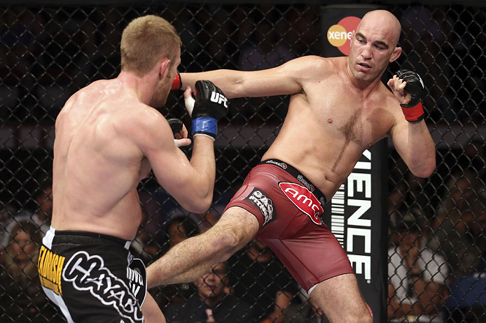 CALGARY, CANADA - JULY 21: (R-L) Brian Ebersole kicks James Head during their welterweight bout at UFC 149 inside the Scotiabank Saddledome on July 21, 2012 in Calgary, Alberta, Canada.  (Photo by Nick Laham/Zuffa LLC/Zuffa LLC via Getty Images)