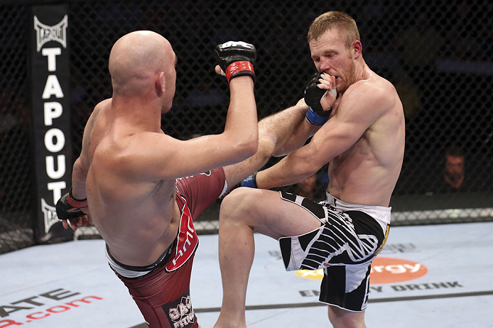 CALGARY, CANADA - JULY 21: (L-R) Brian Ebersole lands a kick to the body of James Head during their welterweight bout at UFC 149 inside the Scotiabank Saddledome on July 21, 2012 in Calgary, Alberta, Canada.  (Photo by Nick Laham/Zuffa LLC/Zuffa LLC via Getty Images)