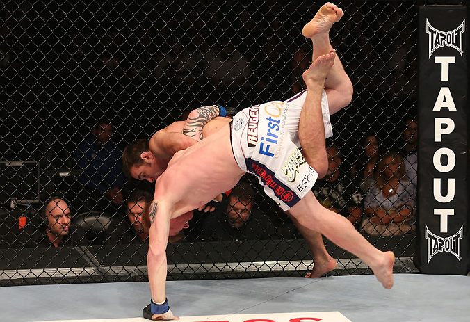DENVER, CO - AUGUST 11:  (R-L) Jake Shields takes down Ed Herman during their middleweight bout at UFC 150 inside Pepsi Center on August 11, 2012 in Denver, Colorado. (Photo by Nick Laham/Zuffa LLC/Zuffa LLC via Getty Images)