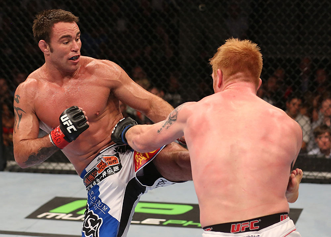 DENVER, CO - AUGUST 11:  (L-R) Jake Shields kicks Ed Herman during their middleweight bout at UFC 150 inside Pepsi Center on August 11, 2012 in Denver, Colorado. (Photo by Nick Laham/Zuffa LLC/Zuffa LLC via Getty Images)