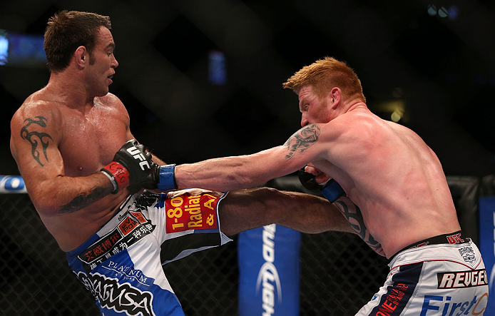 DENVER, CO - AUGUST 11:  (L-R) Jake Shields kicks Ed Herman during their middleweight bout at UFC 150 inside Pepsi Center on August 11, 2012 in Denver, Colorado. (Photo by Josh Hedges/Zuffa LLC/Zuffa LLC via Getty Images)