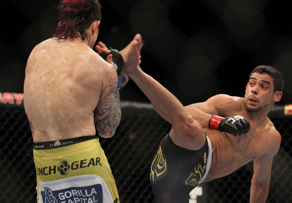 LAS VEGAS, NV - FEBRUARY 04:  Renan Barao (right) attempts to kick Scott Jorgensen during the UFC 143 event at Mandalay Bay Events Center on February 4, 2012 in Las Vegas, Nevada.  (Photo by Josh Hedges/Zuffa LLC/Zuffa LLC via Getty Images) *** Local Caption *** Renan Barao; Scott Jorgensen