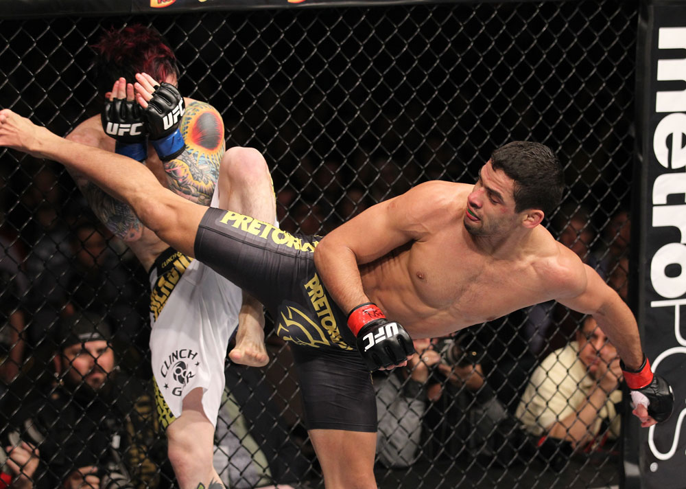 LAS VEGAS, NV - FEBRUARY 04:  Renan Barao (right) delivers a roundhouse kick to Scott Jorgensen during the UFC 143 event at Mandalay Bay Events Center on February 4, 2012 in Las Vegas, Nevada.  (Photo by Nick Laham/Zuffa LLC/Zuffa LLC via Getty Images) *** Local Caption *** Renan Barao; Scott Jorgensen