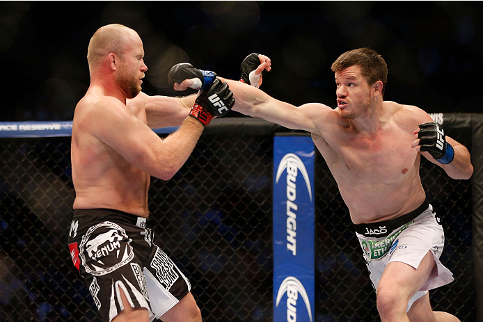 HOUSTON, TEXAS - OCTOBER 19:  (R-L) CB Dollaway punches Tim Boetsch in their UFC middleweight bout at the Toyota Center on October 19, 2013 in Houston, Texas. (Photo by Josh Hedges/Zuffa LLC/Zuffa LLC via Getty Images)