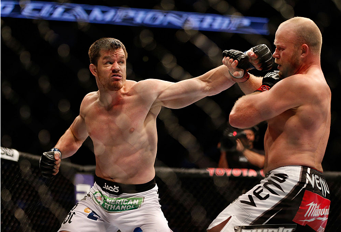 HOUSTON, TEXAS - OCTOBER 19:  (L-R) CB Dollaway punches Tim Boetsch in their UFC middleweight bout at the Toyota Center on October 19, 2013 in Houston, Texas. (Photo by Josh Hedges/Zuffa LLC/Zuffa LLC via Getty Images)