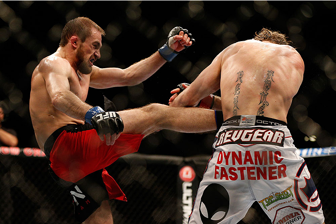 LAS VEGAS, NV - NOVEMBER 16:  (L-R) Ali Bagautinov kicks Tim Elliott in their flyweight bout during the UFC 167 event inside the MGM Grand Garden Arena on November 16, 2013 in Las Vegas, Nevada. (Photo by Josh Hedges/Zuffa LLC/Zuffa LLC via Getty Images) *** Local Caption *** Tim Elliott; Ali Bagautinov