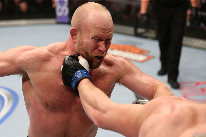 HOUSTON, TEXAS - OCTOBER 19:  Tim Boetsch (L) gets punched by CB Dollaway  in their UFC middleweight bout at the Toyota Center on October 19, 2013 in Houston, Texas. (Photo by Nick Laham/Zuffa LLC/Zuffa LLC via Getty Images)