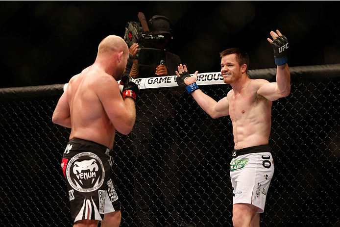 HOUSTON, TEXAS - OCTOBER 19:  (R-L) CB Dollaway taunts Tim Boetsch in their UFC middleweight bout at the Toyota Center on October 19, 2013 in Houston, Texas. (Photo by Josh Hedges/Zuffa LLC/Zuffa LLC via Getty Images)