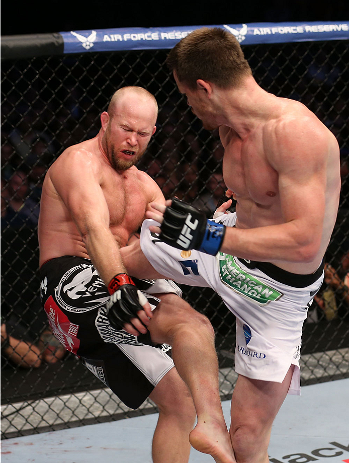 HOUSTON, TEXAS - OCTOBER 19:  (R-L) CB Dollaway kicks Tim Boetsch in their UFC middleweight bout at the Toyota Center on October 19, 2013 in Houston, Texas. (Photo by Nick Laham/Zuffa LLC/Zuffa LLC via Getty Images)
