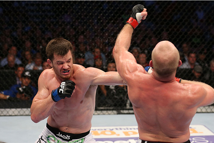 HOUSTON, TEXAS - OCTOBER 19:  (L-R) CB Dollaway punches Tim Boetsch in their UFC middleweight bout at the Toyota Center on October 19, 2013 in Houston, Texas. (Photo by Nick Laham/Zuffa LLC/Zuffa LLC via Getty Images)