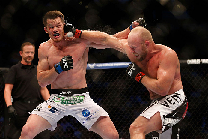 HOUSTON, TEXAS - OCTOBER 19:  (R-L) Tim Boetsch punches CB Dollaway in their UFC middleweight bout at the Toyota Center on October 19, 2013 in Houston, Texas. (Photo by Josh Hedges/Zuffa LLC/Zuffa LLC via Getty Images)