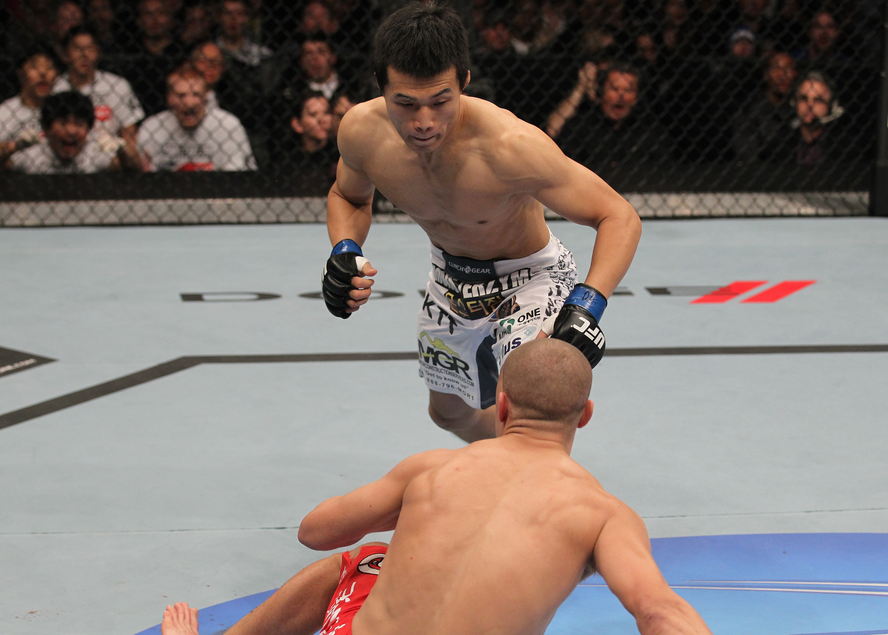 "TORONTO, ON - DECEMBER 10:  (L-R) ""The Korean Zombie"" Chan Sung Jung rushes in to finish Mark Hominick after knocking him down with a punch during the UFC 140 event at Air Canada Centre on December 10, 2011 in Toronto, Ontario, Canada.  (Photo by Nick Laham/Zuffa LLC/Zuffa LLC via Getty Images)"