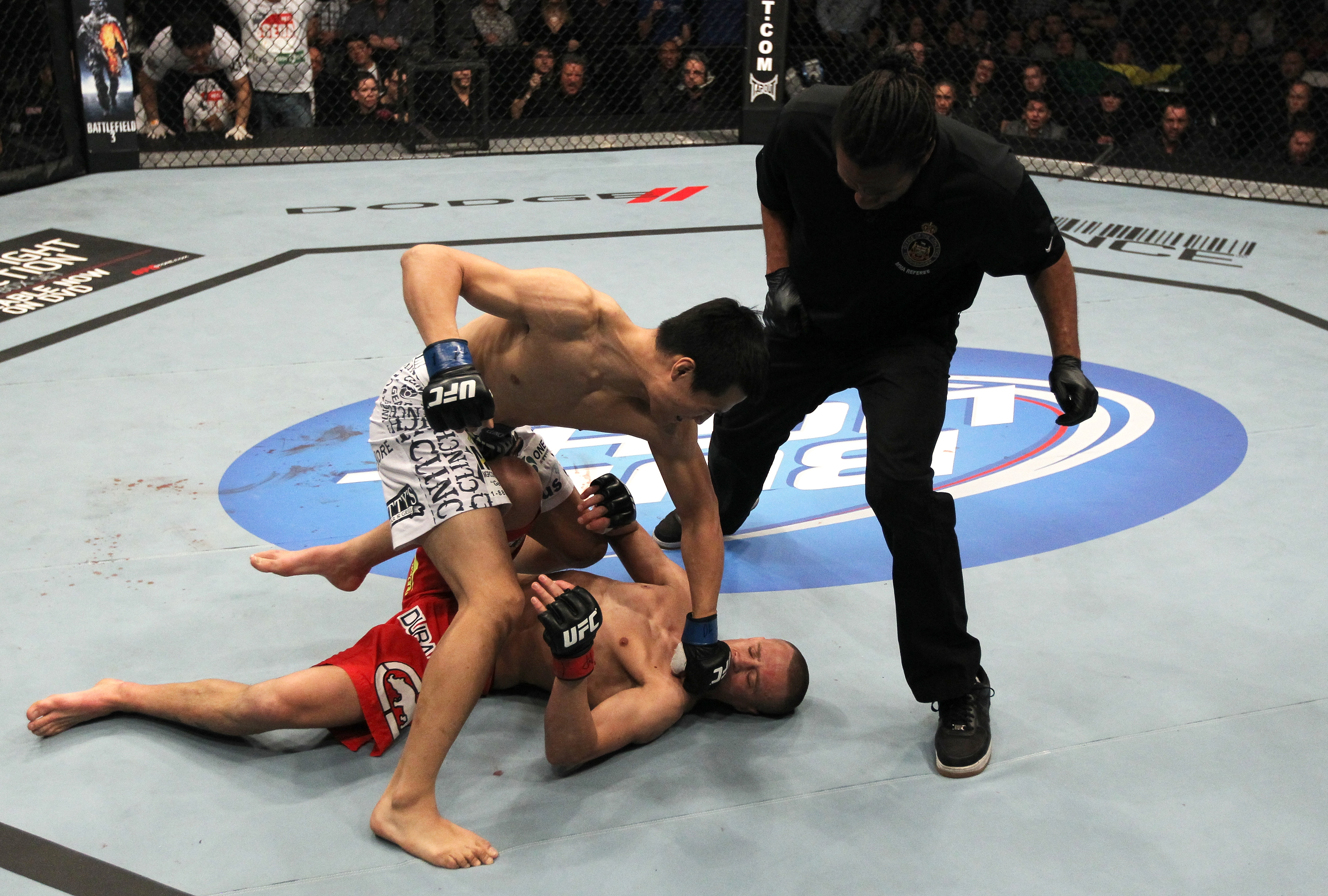 "TORONTO, ON - DECEMBER 10: (L-R) ""The Korean Zombie"" Chan Sung Jung defeats Mark Hominick by knockout during the UFC 140 event at Air Canada Centre on December 10, 2011 in Toronto, Ontario, Canada. (Photo by Nick Laham/Zuffa LLC/Zuffa LLC via Getty Images)"