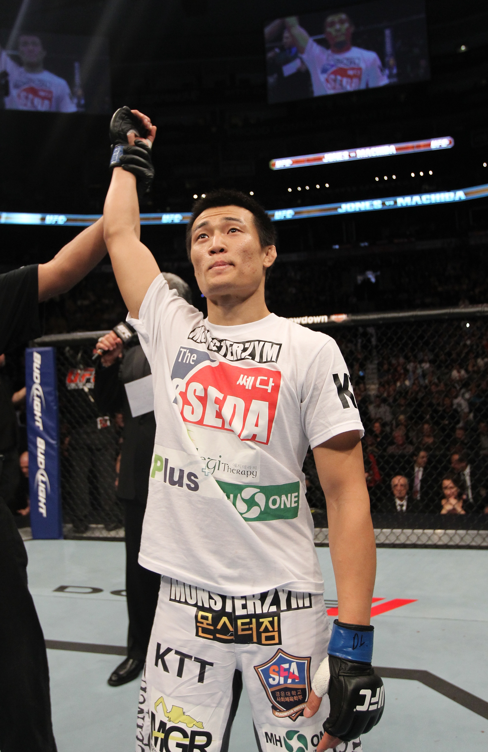 "TORONTO, ON - DECEMBER 10:  ""The Korean Zombie"" Chan Sung Jung reacts after knocking out Mark Hominick during the UFC 140 event at Air Canada Centre on December 10, 2011 in Toronto, Ontario, Canada.  (Photo by Nick Laham/Zuffa LLC/Zuffa LLC via Getty Images)"