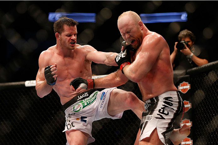 HOUSTON, TEXAS - OCTOBER 19:  (L-R) CB Dollaway eye gouges Tim Boetsch in their UFC middleweight bout at the Toyota Center on October 19, 2013 in Houston, Texas. (Photo by Josh Hedges/Zuffa LLC/Zuffa LLC via Getty Images)