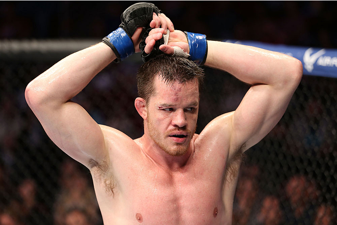 HOUSTON, TEXAS - OCTOBER 19:  CB Dollaway walks to his corner during a stoppage in fight against Tim Boetsch (not pictured) in their UFC middleweight bout at the Toyota Center on October 19, 2013 in Houston, Texas. (Photo by Nick Laham/Zuffa LLC/Zuffa LLC via Getty Images)
