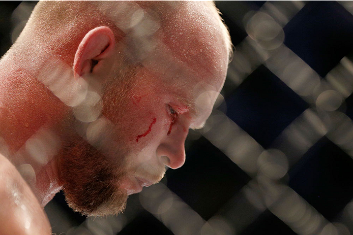 HOUSTON, TEXAS - OCTOBER 19:  Tim Boetsch rests in his corner after being eye gouged by CB Dollaway (not pictured) in their UFC middleweight bout at the Toyota Center on October 19, 2013 in Houston, Texas. (Photo by Josh Hedges/Zuffa LLC/Zuffa LLC via Getty Images)