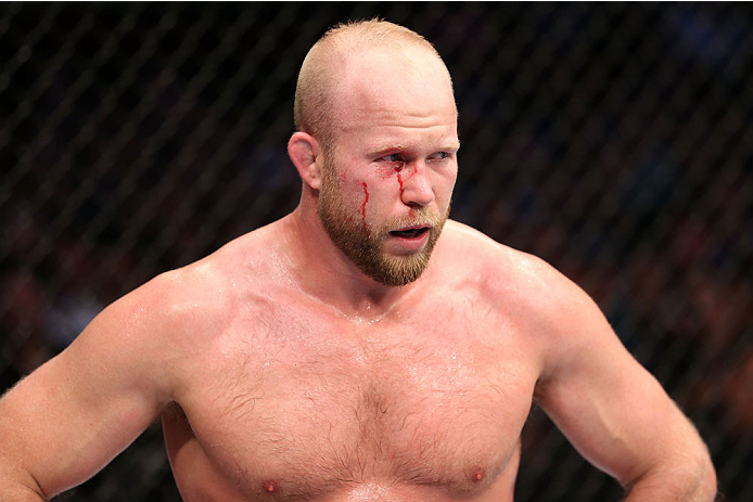 HOUSTON, TEXAS - OCTOBER 19:  Tim Boetsch walks to his corner after being eye gouged by CB Dollaway (not pictured) in their UFC middleweight bout at the Toyota Center on October 19, 2013 in Houston, Texas. (Photo by Nick Laham/Zuffa LLC/Zuffa LLC via Getty Images)