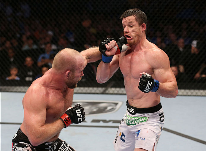 HOUSTON, TEXAS - OCTOBER 19:  (L-R) Tim Boetsch punches CB Dollaway in their UFC middleweight bout at the Toyota Center on October 19, 2013 in Houston, Texas. (Photo by Nick Laham/Zuffa LLC/Zuffa LLC via Getty Images)