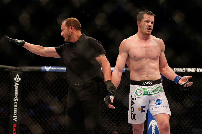 HOUSTON, TEXAS - OCTOBER 19:  CB Dollaway is penalized after multiple eye gouges to Tim Boetsch (not pictured) in their UFC middleweight bout at the Toyota Center on October 19, 2013 in Houston, Texas. (Photo by Josh Hedges/Zuffa LLC/Zuffa LLC via Getty Images)