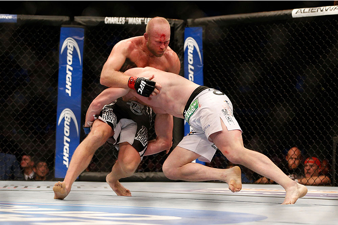 HOUSTON, TEXAS - OCTOBER 19:  (R-L) CB Dollaway takes down Tim Boetsch in their UFC middleweight bout at the Toyota Center on October 19, 2013 in Houston, Texas. (Photo by Josh Hedges/Zuffa LLC/Zuffa LLC via Getty Images)