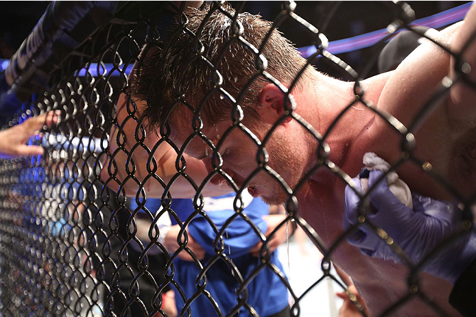 HOUSTON, TEXAS - OCTOBER 19:  CB Dollaway rests in his corner after fighting Tim Boetsch (not pictured) in their UFC middleweight bout at the Toyota Center on October 19, 2013 in Houston, Texas. (Photo by Nick Laham/Zuffa LLC/Zuffa LLC via Getty Images)