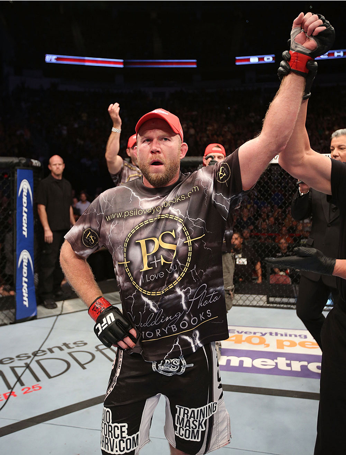 HOUSTON, TEXAS - OCTOBER 19:  Tim Boetsch celebrates after defeating CB Dollaway (not pictured) by split decision in their UFC middleweight bout at the Toyota Center on October 19, 2013 in Houston, Texas. (Photo by Nick Laham/Zuffa LLC/Zuffa LLC via Getty Images)