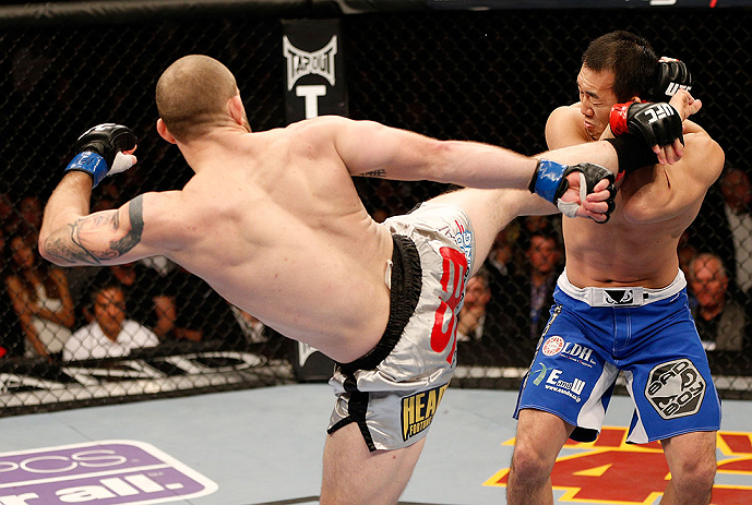 LAS VEGAS, NV - DECEMBER 29:  (L-R) Alan Belcher kicks Yushin Okami during their middleweight fight at UFC 155 on December 29, 2012 at MGM Grand Garden Arena in Las Vegas, Nevada. (Photo by Josh Hedges/Zuffa LLC/Zuffa LLC via Getty Images) *** Local Caption *** Yushin Okami; Alan Belcher