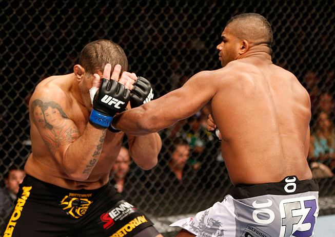 LAS VEGAS, NV - FEBRUARY 02:  (R-L) Alistair Overeem punches Antonio Silva during their heavyweight fight at UFC 156 on February 2, 2013 at the Mandalay Bay Events Center in Las Vegas, Nevada.  (Photo by Josh Hedges/Zuffa LLC/Zuffa LLC via Getty Images) *** Local Caption *** Alistair Overeem; Antonio Silva