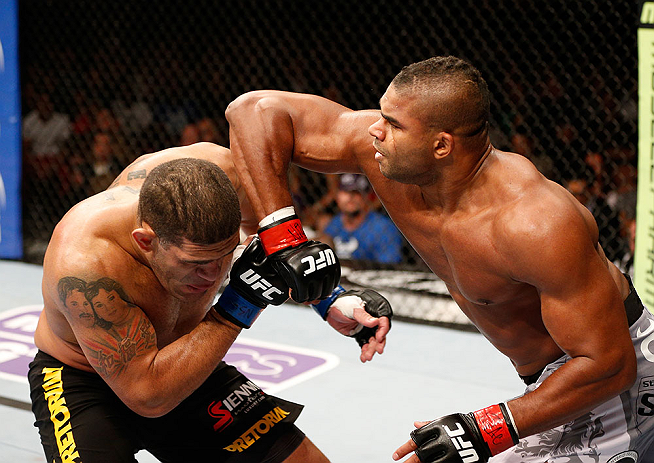 LAS VEGAS, NV - FEBRUARY 02:  (R-L) Alistair Overeem elbows Antonio Silva during their heavyweight fight at UFC 156 on February 2, 2013 at the Mandalay Bay Events Center in Las Vegas, Nevada.  (Photo by Josh Hedges/Zuffa LLC/Zuffa LLC via Getty Images) *** Local Caption *** Alistair Overeem; Antonio Silva