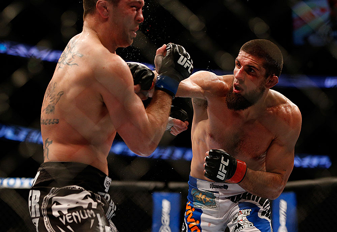 ANAHEIM, CA - FEBRUARY 23:  (R-L) Josh Neer punches Court McGee in their welterweight bout during UFC 157 at Honda Center on February 23, 2013 in Anaheim, California.  (Photo by Josh Hedges/Zuffa LLC/Zuffa LLC via Getty Images) *** Local Caption *** Court McGee; Josh Neer