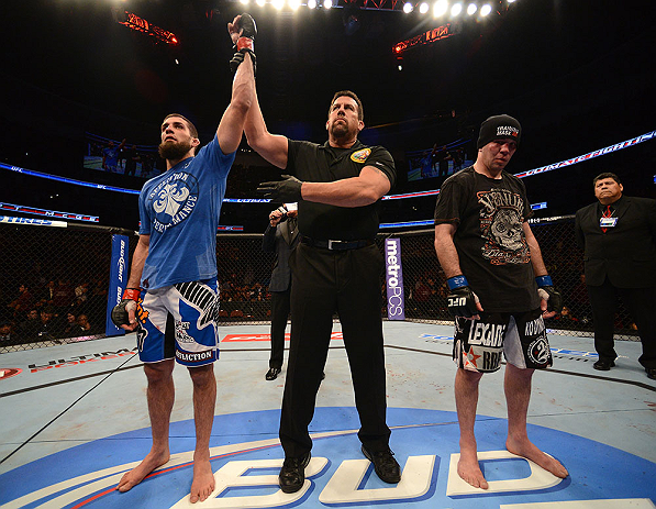 ANAHEIM, CA - FEBRUARY 23:  Court McGee (left) is declared the winner over Josh Neer in their welterweight bout during UFC 157 at Honda Center on February 23, 2013 in Anaheim, California.  (Photo by Donald Miralle/Zuffa LLC/Zuffa LLC via Getty Images) *** Local Caption *** Court McGee; Josh Neer