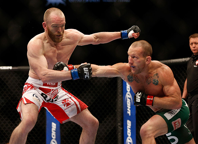 LAS VEGAS, NV - MAY 25:   (R-L) Gray Maynard punches T.J. Grant in their lightweight bout during UFC 160 at the MGM Grand Garden Arena on May 25, 2013 in Las Vegas, Nevada.  (Photo by Josh Hedges/Zuffa LLC/Zuffa LLC via Getty Images)  *** Local Caption *** Gray Maynard; T.J. Grant