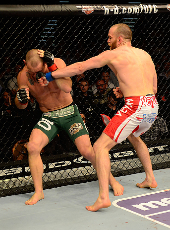 LAS VEGAS, NV - MAY 25:   (R-L) T.J. Grant punches Gray Maynard in their lightweight bout during UFC 160 at the MGM Grand Garden Arena on May 25, 2013 in Las Vegas, Nevada.  (Photo by Donald Miralle/Zuffa LLC/Zuffa LLC via Getty Images)  *** Local Caption *** Gray Maynard; T.J. Grant