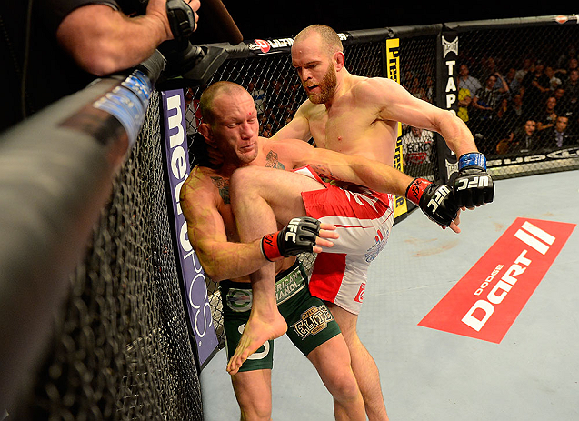 LAS VEGAS, NV - MAY 25:   (R-L) T.J. Grant knees Gray Maynard in their lightweight bout during UFC 160 at the MGM Grand Garden Arena on May 25, 2013 in Las Vegas, Nevada.  (Photo by Donald Miralle/Zuffa LLC/Zuffa LLC via Getty Images)  *** Local Caption *** Gray Maynard; T.J. Grant