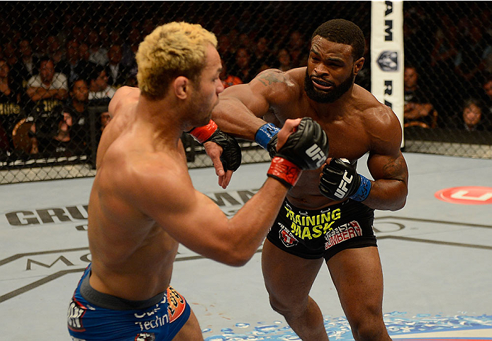 LAS VEGAS, NV - NOVEMBER 16:  (R-L) Tyron Woodley punches Josh Koscheck in their welterweight bout during the UFC 167 event inside the MGM Grand Garden Arena on November 16, 2013 in Las Vegas, Nevada. (Photo by Donald Miralle/Zuffa LLC/Zuffa LLC via Getty Images) *** Local Caption *** Josh Koscheck; Tyron Woodley