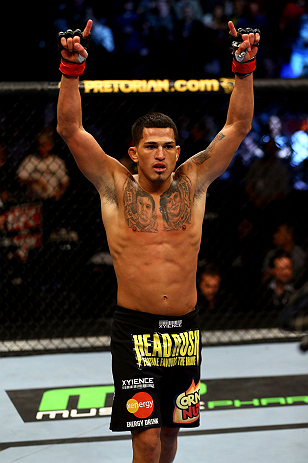 CHICAGO, IL - JANUARY 26:  Anthony Pettis celebrates defeating Donald Cerrone during their Lightweight Bout part of UFC on FOX at United Center on January 26, 2013 in Chicago, Illinois.  (Photo by Al Bello/Zuffa LLC/Zuffa LLC Via Getty Images)